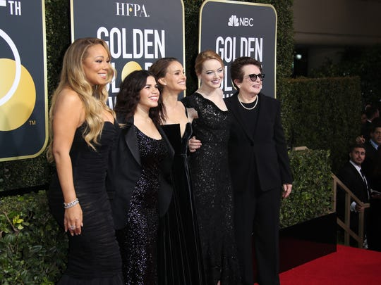 Mariah Carey, America Ferrera, Natalie Portman, Emma Stone and Billie Jean King arrive wearing black during the 75th Golden Globe Awards.