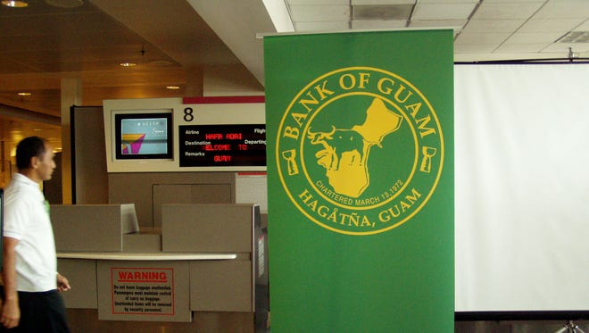The Bank of Guam logo is displayed in front of the Northwest/Delta Air Lines gate at  the A.B. Won Pat Guam International Airport.