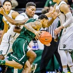 MSU's Javon Bess defends Eastern Michigan's Raven Lee during last year's matchup in East Lansing. Lee, who averaged 16.7 points per game last season in MAC play, is now coming off the bench for the Eagles. Bess is starting for the Spartans, averaging 10.3 points per game.