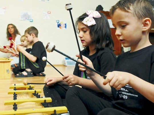 Lucas Campanella, 5, foreground, and Soraya Kamali, 4, play musical instruments with others during a special program at The Las Cruces Academy of Music and Dance, which offers camps and classes year around for babies and small children.
