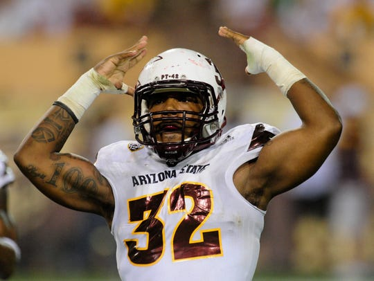 Arizona State linebacker Antonio Longino celebrates