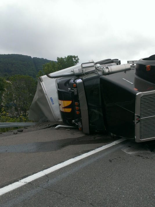 Truck driver ticketed after rollover on I-88