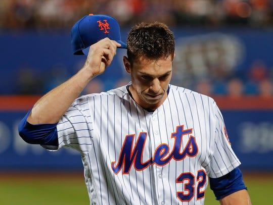 New York Mets starting pitcher Steven Matz walks off