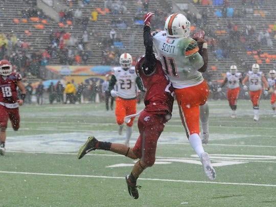 Dec 26, 2015; El Paso, TX, USA; Miami Hurricanes wide receiver Rashawn Scott (11) makes a catch against the Washington State Cougars during the second half at Sun Bowl Stadium. The Cougars won 20-14. Mandatory Credit: Joe Camporeale-USA TODAY Sports