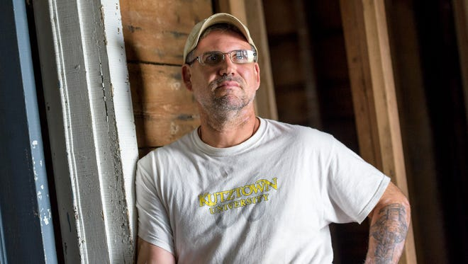 Kevin Conley, a retired U.S. Army veteran, with help from volunteers leads the renovation of a house on South Broad Street in Middletown as part of the Warriors Helping Warriors organization's effort to create a veterans center.