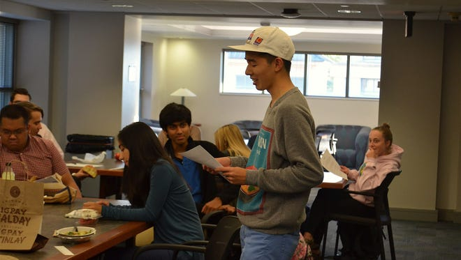Sean Wu, 18, reads an essay last year during a first-year honors seminar at the University of Iowa. Wu died Saturday.