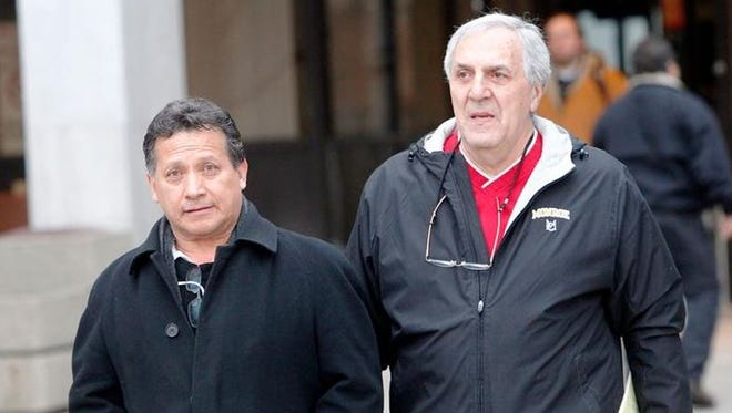Eduardo Galan, left, leaves his court appearance with his attorney John Parrinello, for alleged Federal mail fraud, from the Federal Building in Rochester Wednesday afternoon, March 6, 2013.