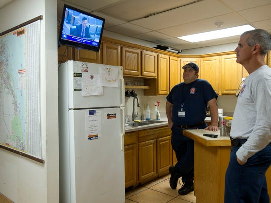 Martin County Fire Rescue workers Chris Myers, firefighter