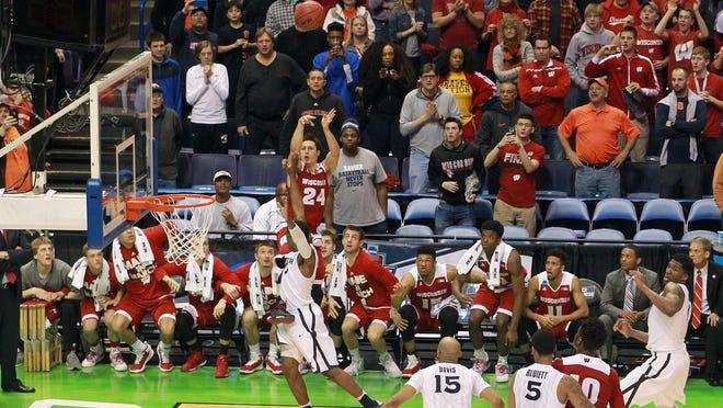 Wisconsin's Bronson Koenig drills the winning shot against Xavier.
