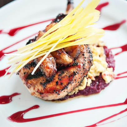 The apple cider-brined pork chop with red cabbage slaw