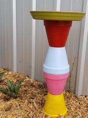Lift  your bird bath by the bottom pot to move it,