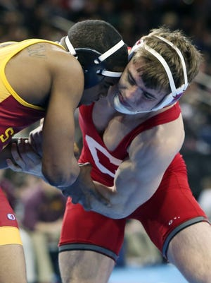 Cornell's Brian Realbuto wrestles against Iowa State's Leland Weatherspoon in the quarterfinals in the 174-pound weight class during the NCAA Wrestling Championships at Madison Square Garden March 17, 2016. Weatherspoon won the match knocking off the number two seed Realbuto.