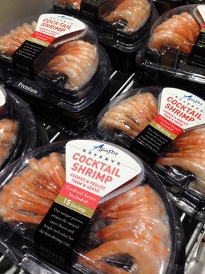 "This Monday, Nov. 30, 2015 photo shows shrimp products from Thailand packaged under the name ""Aqua Star"" at a grocery store in Phoenix."