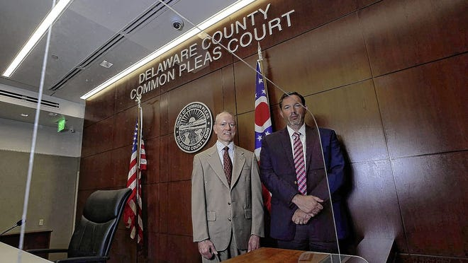 Delaware County Common Pleas Court Judges David Gormley, left, and James P. Schuck stand behind a plexiglass shield in one of the courtrooms in the Delaware County Courthouse in this file photo. The judges believe the plan to create a Delaware County public defenders office will help the court operate more efficiently.