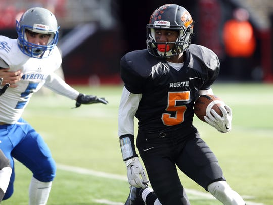 Middletown North's Dwight Wilkerson gains yardage vs. Sayreville in North 2 Group IV sectional football championship at Rutgers University's High Point Solutions Stadium.