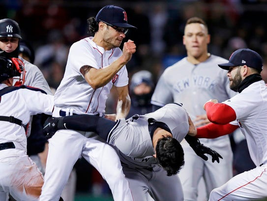 Boston Red Sox relief pitcher Joe Kelly, left, throws