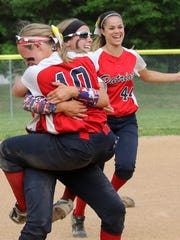 Binghamton softball players celebrate after winning the Section 4 Class AA title over Horseheads Saturday at BAGSAI Complex.