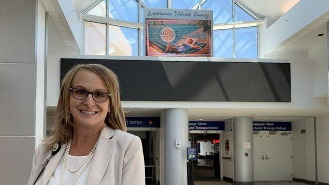 Karen Feaster stands in the concourse at Dayhtna Beach International Airport on Tuesday, June 16, 2020, after being confirmed earlier in the day by the Volusia County Council as the airport's new director. She began working for the airport in 1992 after starting out as an intern.