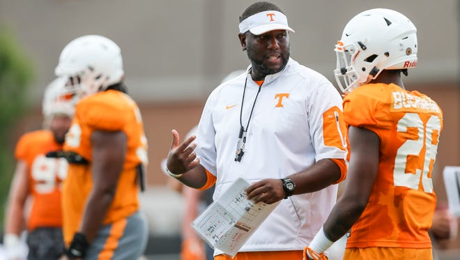 Tennessee's Larry Scott is the first black offensive coordinator in UT's 121-year history of football.