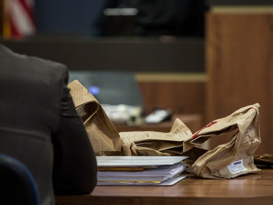 Bags of evidence sit on the prosecution's desk as Elizabeth Long testifies Friday, Feb. 26, 2016 in the courtroom of Judge Michael West at the St. Clair County Courthouse in Port Huron. Elizabeth Long is charged with second-degree murder and second-degree child abuse in the death of her 16-month-old son Lukas.