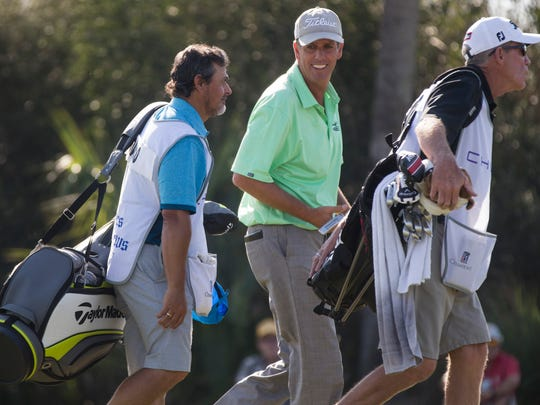 PGA Tour Pro Doug Harwood, center, is all smiles after tying for first at seven-under par after the first round of action during The Chubb Classic at TwinEagles Club Friday, Feb. 17, 2017 in Naples.