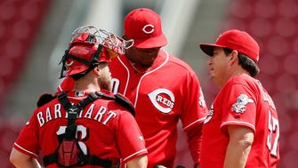 Reds pitching coach Mack Jenkins (right) talks with reliever Jumbo Diaz on the mound in the seventh inning of Monday's loss to the Dodgers at Great American Ball Park.