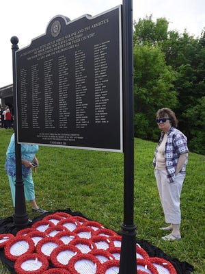JoAnne Brosig of Erie looks at the Erie County World War I Memorial during a ceremony in May 2019. Brosig's grandfather, Walter Paluke, served in the U.S. Army and died in France.