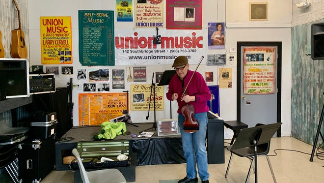 Victor Evdokimoff practices bluegrass fiddle in the performance room.