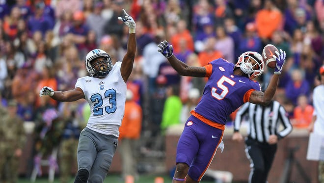 Clemson wide receiver Tee Higgins (5) makes a 1 hand catch on his way to scoring on a 78-yard catch and run against The Citadel during the 3rd quarter on Saturday, November 18, 2017 at Clemson's Memorial Stadium.