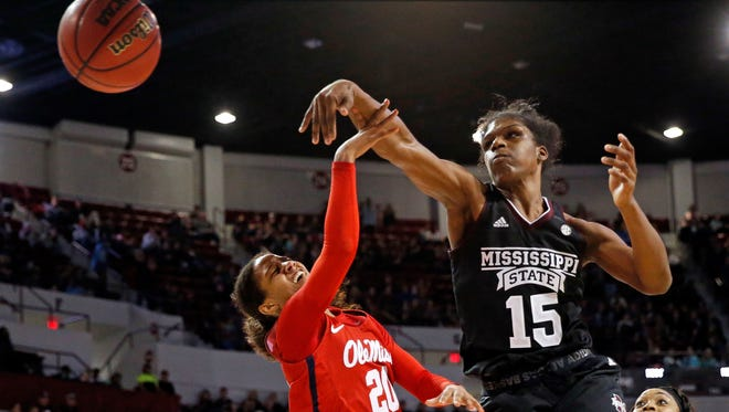 Mississippi State center Teaira McCowan (15) blocks a shot by Mississippi guard Madinah Muhammad (20).