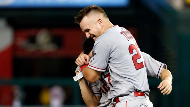 Mike Trout of the Los Angeles Angels (27) jokes Jose Altuve of the Houston Astros (27) during the fifth inning of the All-Star Game.
