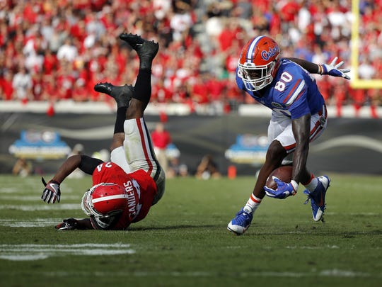 Oct 29, 2016; Jacksonville, FL, USA; Florida Gators tight end C'yontai Lewis (80) runs past Georgia Bulldogs safety Dominick Sanders (24) as he scores a touchdown during the first half at EverBank Field. Mandatory Credit: Kim Klement-USA TODAY Sports