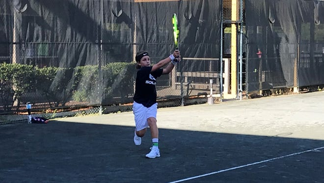 Jackson Hinderberger finishes off his Boys 12 singles title at the Walk-On's Independence Bowl Junior Tennis Classic.