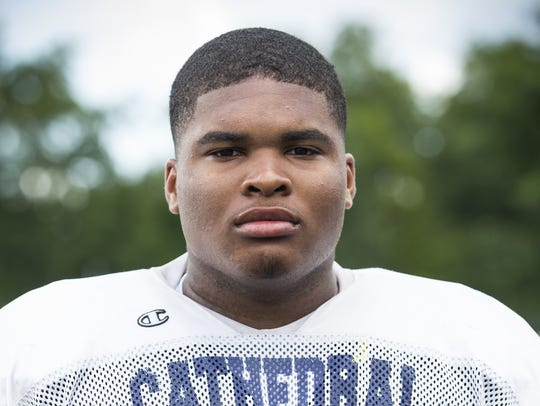Cathedral offensive lineman Emil Ekiyor.