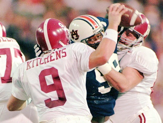 -  -Auburn's Shannon Suttle (99) sacks Alabama's Freddie