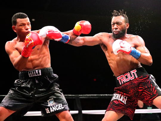 Austin Trout, right, of Las Cruces, takes a jab at Juan De Angel of Barranquilla, Colombia, on Saturday night at the Don Haskins Center. Trout won by unanimous decision.
