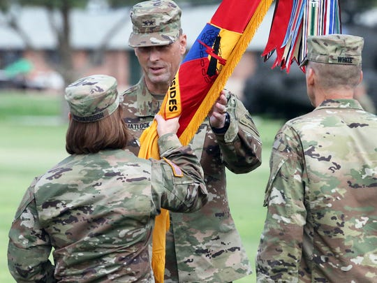 """Maj. Gen. Patrick E. Matlock, center, incoming commander of the 1st Armored Division and Fort Bliss, receives the colors of the division from Lt. Gen. Laura J. Richardson during a change of command ceremony Thursday on post. Matlock succeeds Maj. Gen. Robert """"Pat"""" White, right."""