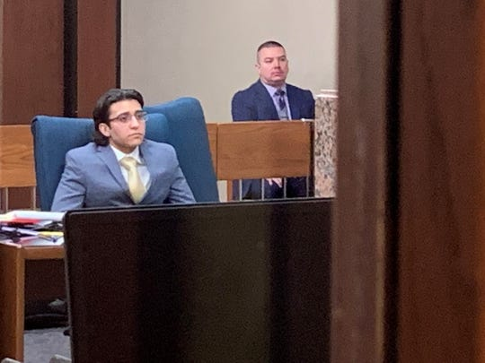 Marcelo Mailland, left, sits in the 41st District Court Monday during the opening day of his capital murder trial. He is charged in connection with the fatal shooting of Christian Jorjorian.