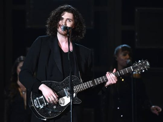 Hozier performs at the 57th annual Grammy Awards on