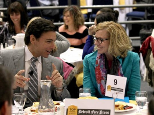 Ford President and CEO Mark Fields talks to Michigan.com President Joyce Jenereaux during the 2014 Detroit Free Press Top Workplaces breakfast at the Shriners' Silver Garden Event Center in Southfield.