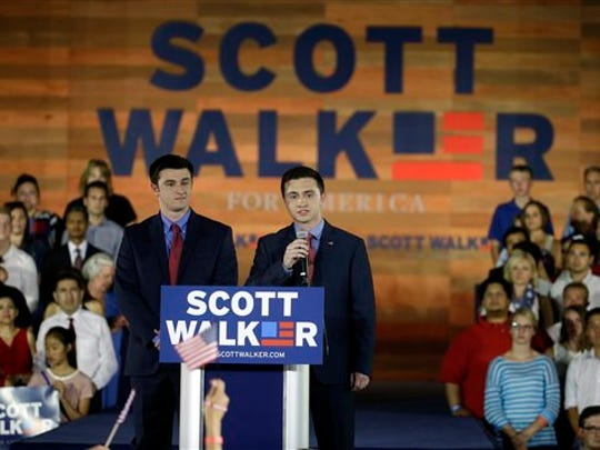 Wisconsin Gov. Scott Walker's sons Alex, left, and Matt speak to supporters before their father announces he is running for the 2016 Republican presidential nomination, Waukesha County Expo Center, Monday, July 13, 2015, in Waukesha, Wis. (AP Photo/Morry Gash)