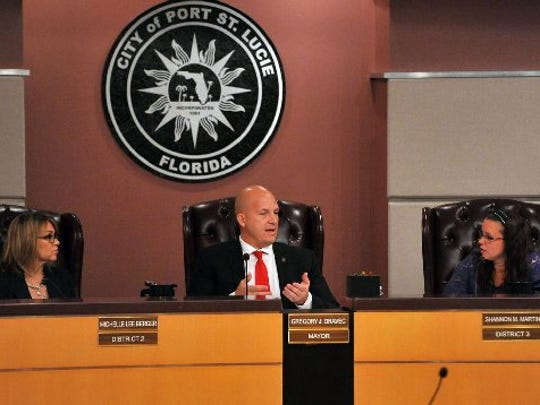 Port St. Lucie Mayor Gregory Oravec (center) talks with City Council members Shannon Martin (right) and Michelle Berger as they vote Feb. 16, 2016, to terminate City Attorney Pam Booker during a special meeting.