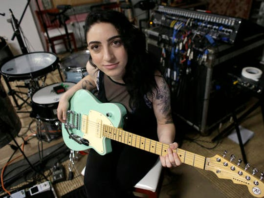 "In this Jan. 31, 2017 photo, Emily Estefan poses after band practice in the garage of her late grandparent's mansion in Miami Beach, Fla. Estefan, the daughter of Gloria and Emilio Estefan released her debut album,"" ""Take Whatever You Want,"" on Feb. 3."