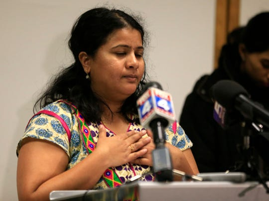 """Sunayana Dumala holds her heart while talking about her late husband, Srinivas Kuchibhotla, during a news conference at Garmin Headquarters in Olathe, Kan., Friday, Feb. 24, 2017. Witnesses say a man accused of opening fire in a crowded bar yelled at two Indian men to """"get out of my country"""" before pulling the trigger. The attack killed one of the men and wounded the other, as well as a third man who tried to help."""