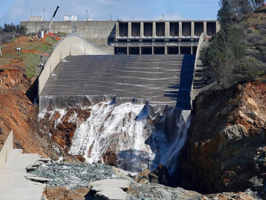 In this Feb. 28, 2017, file photo, water goes down Oroville Dam's crippled spillway in Oroville.