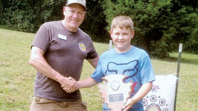 Brody Wriston of Cottageville receives his winning plaque from Rusty Reed, president of the West Virginia Bowhunters Association.