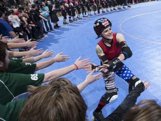 Maiden America (Melissa Smith), slaps hands during player introductions in the evening's Naptown Roller Girls main event at Bankers Life Fieldhouse, Indianapolis, Friday, April 20, 2012. NRG's Tornado Sirens beat the Tampa Bay Tantrums 149-126. Robert Scheer/The Star