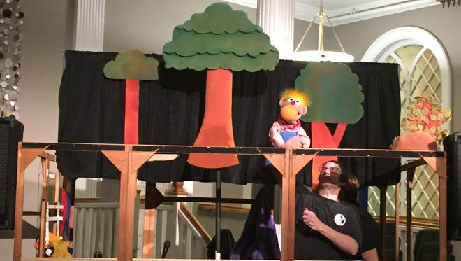 Rick Lyon, puppet designer for the Tony Award-winning Avenue Q musical, demonstrating puppetry to an audience at the Nyack Center on Jan. 17, 2016.
