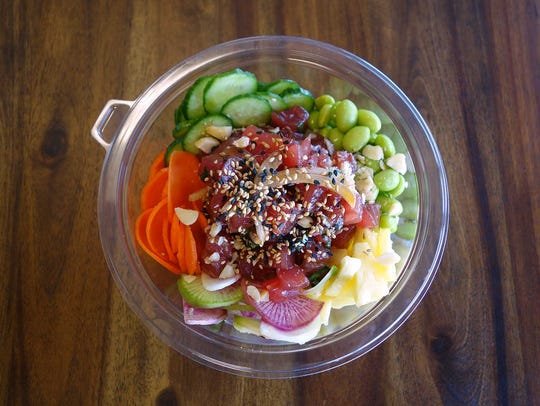 Chula Seafood's Hawaiian-style poke with yellowfin tuna, cucumber, radish, pineapple, edamame, onion, macadamia nut, sesame, soy, ginger, garlic and rice.