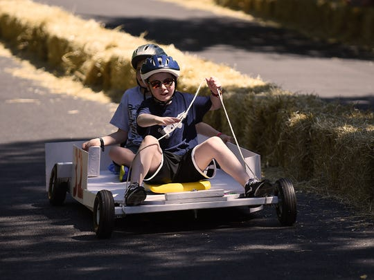 "Second annual Downhill Derby in Rutherford, NJ on Saturday June 16, 2018. (Front) Tom Cinque, 11 years old and (back) Christian Cinque, 13 years old race in their car ""Team Cinque""."